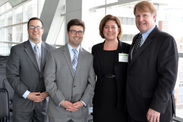 Anna Siefken with (from left) Grant Ervin, Corey O'Connor and Rich Fitzgerald, supporters of the Pittsburgh 2030 District initiative.