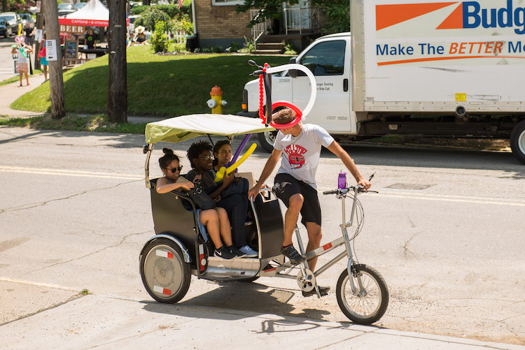 Pedicabs made their way from Grandview Park to Boggs and Bailey. Rob Larson photo