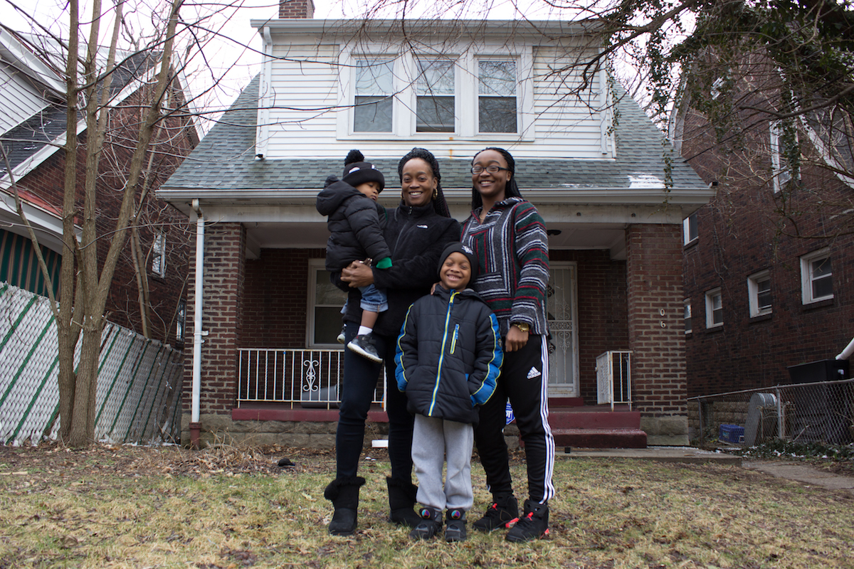 DeShawn Daniels and family in front of the house that will soon be hers. Photo courtesy of Open Hand Ministries.