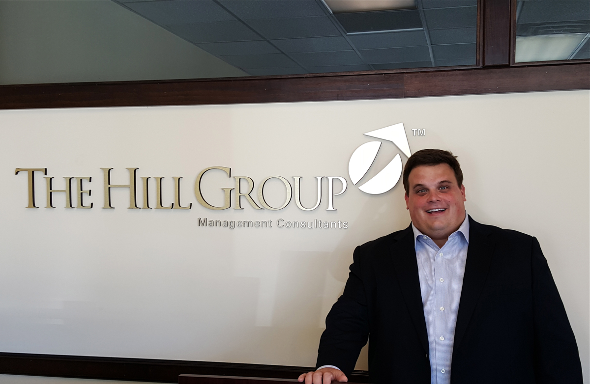 Jordan at The Hill Group office in Carnegie.
