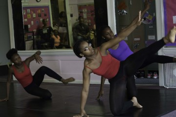 Students  (l-r) Bria Wright, Bria Goldsmith, and Amya Nance, demostrate for Hill Dance Academy Theatre supporters. Photo by E.A. Smith.