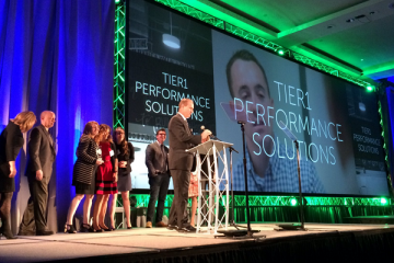 TiER1 Performance Solutions accepts their Tech 50 award. Image courtesy of PTC.