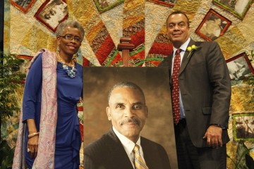 Valerie Njie (left) poses with a photo of Jesse W. Fife Jr. Photo by Germaine Watkins: MCG Photography.