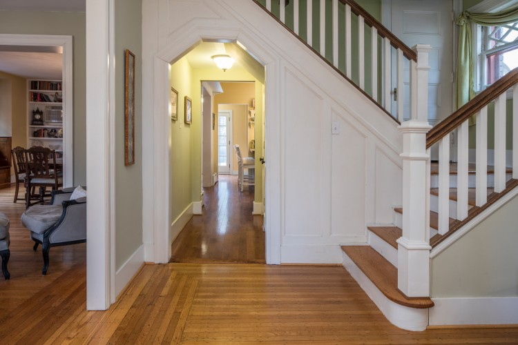A welcoming foyer is decorated with clean lines, open floor plan and wood molding.