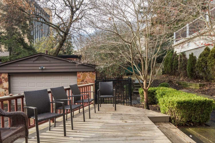 Fenced in backyard with multi-level yard and deck. It features a over sized, double car garage and private driveway.