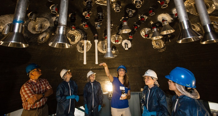Westinghouse employee Lexi Scalia (third from right) points out welds during Introduce a Girl to Engineering at the Westinghouse's Waltz Mill facility. Image courtesy of Westinghouse.