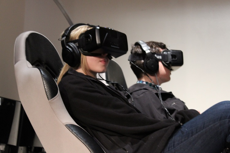 Strapped in for the CMU Hyperloop virtual reality simulator. Photo by Amanda Waltz.