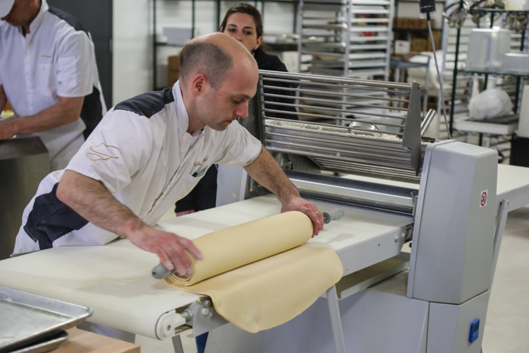 Owner Fabien Moreau prepares pastry dough in the new Hazelwood facility.