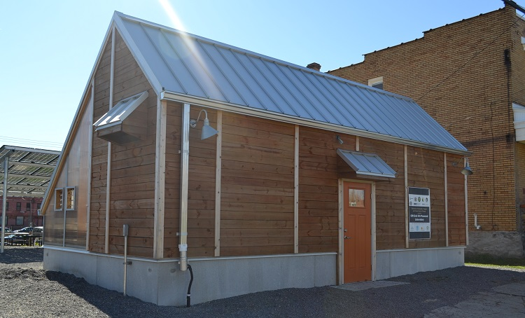 Oasis Farm and Fishery's solar-powered laboratory. Image courtesy of Bible Center Church.