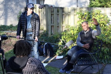 """""""The Rehabilitation of The Hill"""" actor Joshua Elijah Reese (right) doing a behind-the-scenes interview. Photo by Amanda Waltz."""